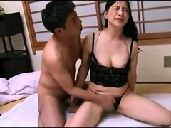 Stacked Oriental mom has a young cock plowing her hairy slit