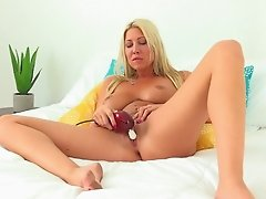 Hot blonde plays with her pussy while moaning softly
