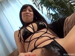 Asian hottie Ueno Naho wears tight clothes while she rubs her cunt