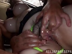 Hands grope the curvy body of the Japanese slut in a hood