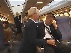 Hot blonde flight attendant masturbating an asian passenger